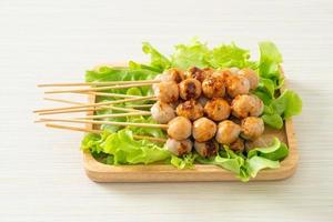 Grilled meatballs skewer with spicy dipping sauce photo
