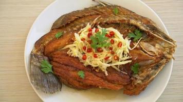 Deep Fried Sea Bass Fish in Fish Sauce with Spicy Salad video