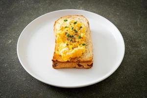 Bread toast with scramble egg on white plate photo