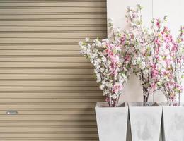 Plastic sakura in vase with copy space photo