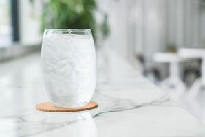 A glass of water with ice photo