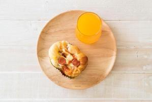 Sausage mayonnaise bread with orange juice on wood plate photo