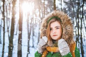 Winter portrait of a beautiful girl in a hat and mittens photo