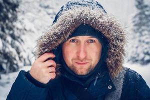 Portrait of a man in winter clothes photo