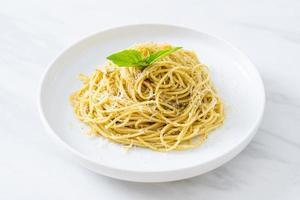 Pesto spaghetti pasta - vegetarian food and Italian food style photo