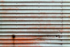 Textura de placa de metal azul grunge. foto