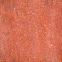 Fondo de textura de piedra rugosa roja. foto