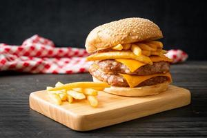 pork burger with cheese and french fries photo