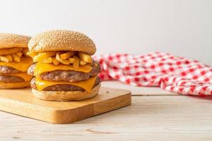 Pork hamburger or pork burger with cheese and french fries photo