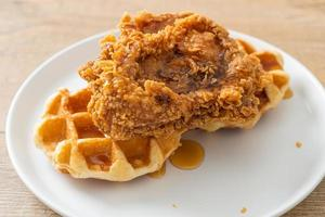 Homemade fried chicken waffle with honey or maple syrup photo