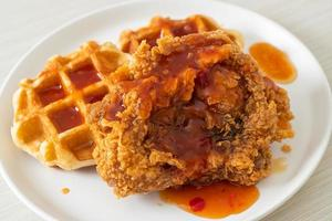 Homemade fried chicken with waffle and spicy sauce photo