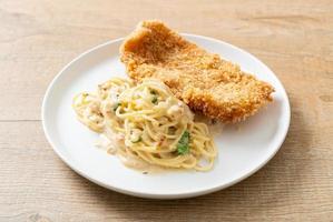 Homemade spaghetti pasta white cream sauce with fried fish photo