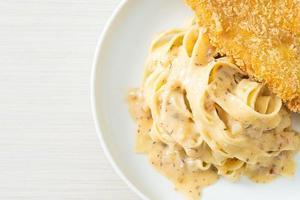 Homemade fettuccine pasta white cream sauce with fried fish photo