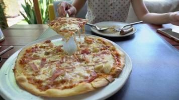 young woman eat italian pizza at restaurant video