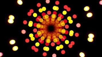 Rotación de partículas de bokeh de luz roja y amarilla. video