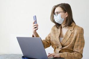 Coronavirus. Quarantine. Business lady solves work issues remotely. photo