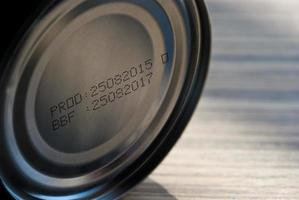 Expire date printed on bottom of canned food photo