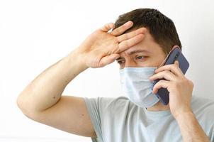 A man calls a doctor. Fever, cough. Complaint about symptoms. photo