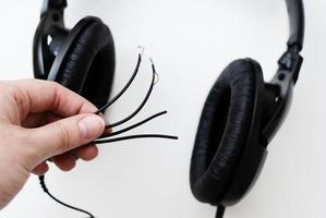 Broken headphones closeup. Broken wires. Photo. photo
