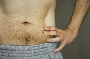 The hairy belly of a young man. photo