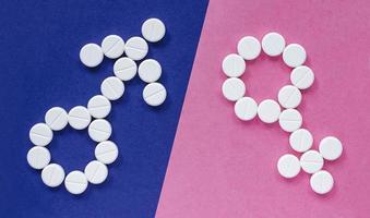 signo de hombre y mujer de pastillas. género foto