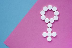 signo de una mujer de pastillas. género foto