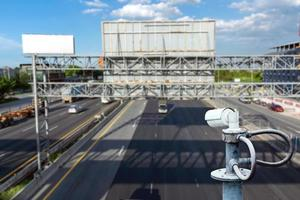 CCTV cameras on the overpass for recording road traffic. photo