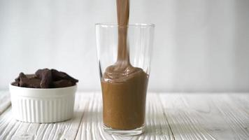 Pouring a Chocolate Smoothie into a Milkshake video