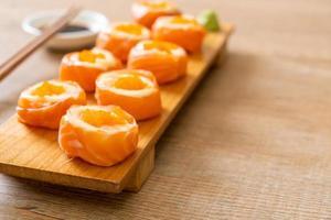 Fresh salmon sushi roll with mayonnaise and shrimp egg - Japanese food style photo