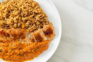 Grilled chicken steak with red curry sauce and rice - Muslim food style photo