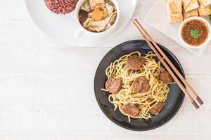 Stir-fried noodle with fried tofu - vegan food photo
