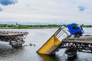 Destruction of bridge structures across the river photo