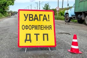 Road sign on the track meaning traffic accident photo