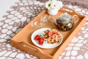Delicious fresh baked belgian waffles with berries and fruit photo