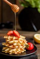 Delicious fresh baked belgian waffles with berries photo