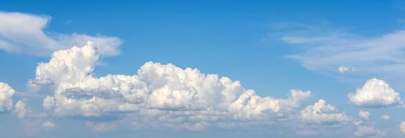 Beautiful white clouds against the background of the sky photo