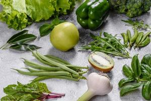 Composition of bright and juicy green vegetables, spices and herbs photo