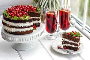 Beautiful delicious cake with bright red berries photo
