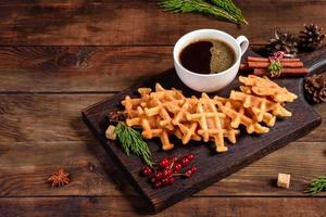 Beautiful delicious Belgian waffles on a Christmas table photo
