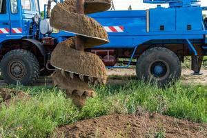 Tracer tractor with auger for soil drilling for piles photo