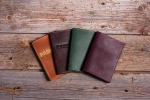 Leather covers for passport on a wooden background photo
