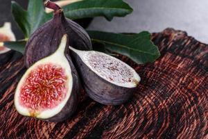 Fresh ripe figs on a dark concrete background. Harvesting figs photo