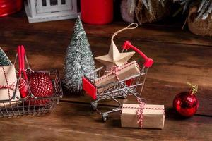 Shopping cart with Christmas gifts and holiday presents photo