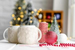 Beautiful multi-colored Christmas decorations on a light wooden table photo