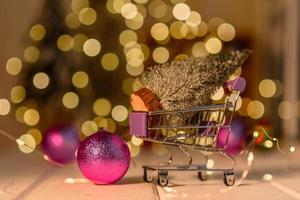 Shopping cart with Christmas gifts and presents. Christmas shopping photo