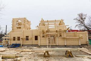 Construction of a Christian church made of wooden treated logs photo