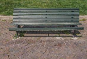 Wooden bench in park photo