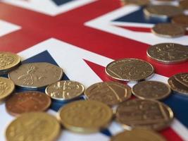 Pound coins, United Kingdom over flag photo