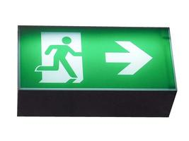Emergency exit sign isolated over white photo