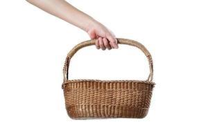 Chef holding wooden basket on white background photo